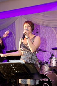 Professional vocalist Lisa Lee sings live at a wedding party.